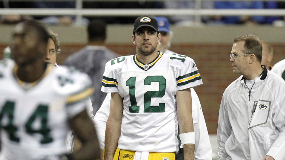 Green Bay quarterback Aaron Rodgers walks off the field at halftime after leaving a game against Detroit with a concussion, Dec. 12, 2010. (Getty Images)