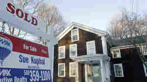 Jan. 10, 2011: A sold sign in front of a home in Millis, Mass.