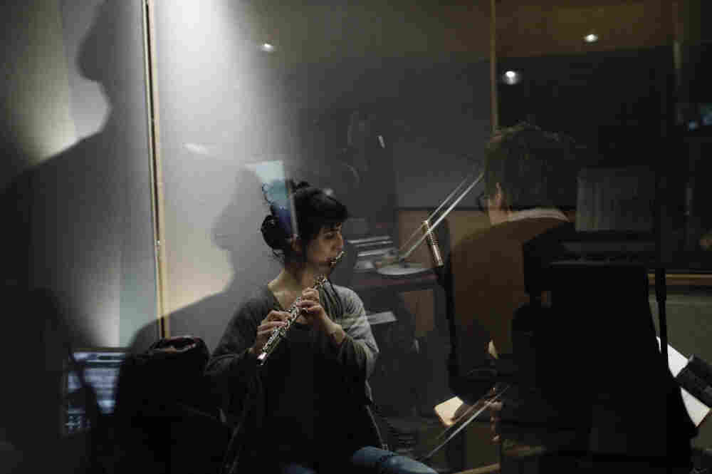 Son Lux (Ryan Lott) in the studio with Alex Sopp (left) of yMusic.