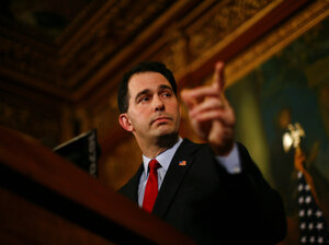 Republican Gov. Scott Walker speaking at a news conference in Madison, Wisconsin on Monday. With state Democrats still in hiding over the legislation proposed by the Governor to restrict collective bargaining for public workers, Walker urged Democratic lawmakers to return to the capitol to conduct business.
