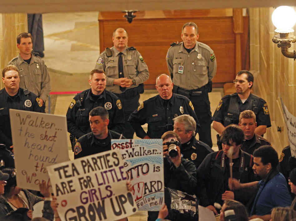 Police and protesters outside Wisconsin Gov. Scott Walker's office, Feb. 22, 2011.