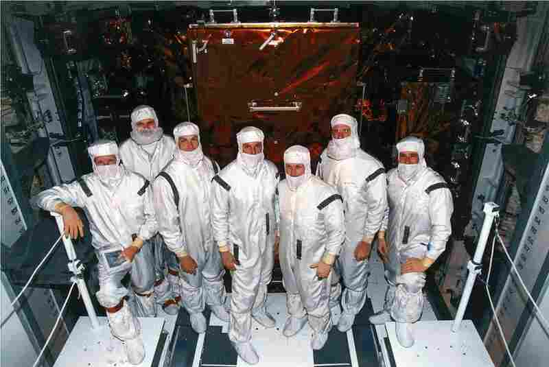 Crew members of STS-82 decked out in their clean room suits at Launch Pad 39A. That's where Discovery underwent final preparations ahead of its 1997 mission to service the Hubble Space Telescope. From left are Mission Specialists Steven A. Hawley and Steven L. Smith, Payload Commander Mark C. Lee, Mission Specialist Gregory J. Harbaugh, Mission Commander Kenneth D. Bowersox, Mission Specialist ...