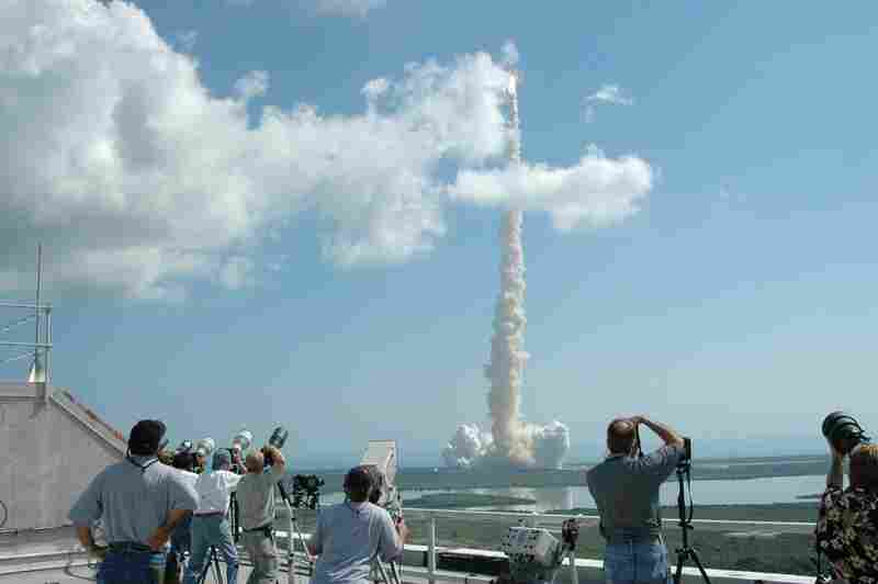 All eyes were on Discovery at NASA's Kennedy Space Center News Center on July 26, 2005. The successful launch was the first space shuttle flight after the shuttle Columbia disintegrated over Texas while re-entering the Earth's atmosphere on Feb. 1, 2003.