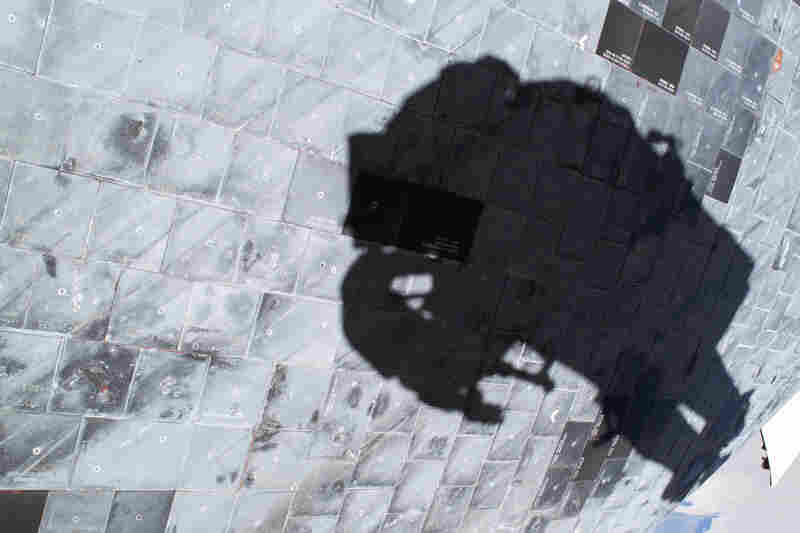 "Astronaut Stephen K. Robinson captured his own shadow in 2005 while photographing a close-up of the thermal tiles that cover Discovery's underside, during the ""Return to Flight"" mission following the space shuttle Columbia disaster."