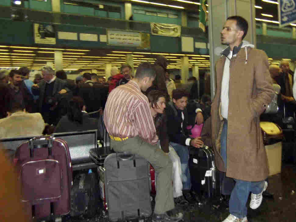 Passengers pack Tripoli's airport Tuesday, desperate to catch a flight and leave Libya. Several countries are sending planes and ferries to Libya to evacuate their citizens.