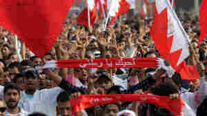 Anti-government protesters march Wednesday in a parade welcoming newly released political prisoners to Pearl Circle in Manama, Bahrain.