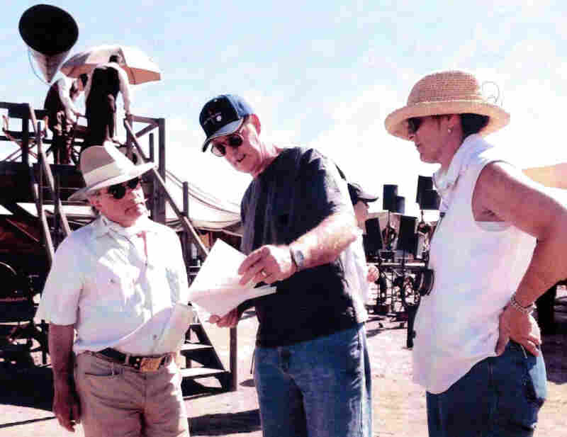 Prop professionals Dennis and Hope Parrish (center and right) consult with director Martin Scorsese on the set of The Aviator.