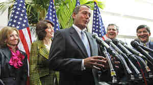 House Speaker John Boehner, flanked by other Republicans, talks shortly before the House voted to repeal the health care law in January.