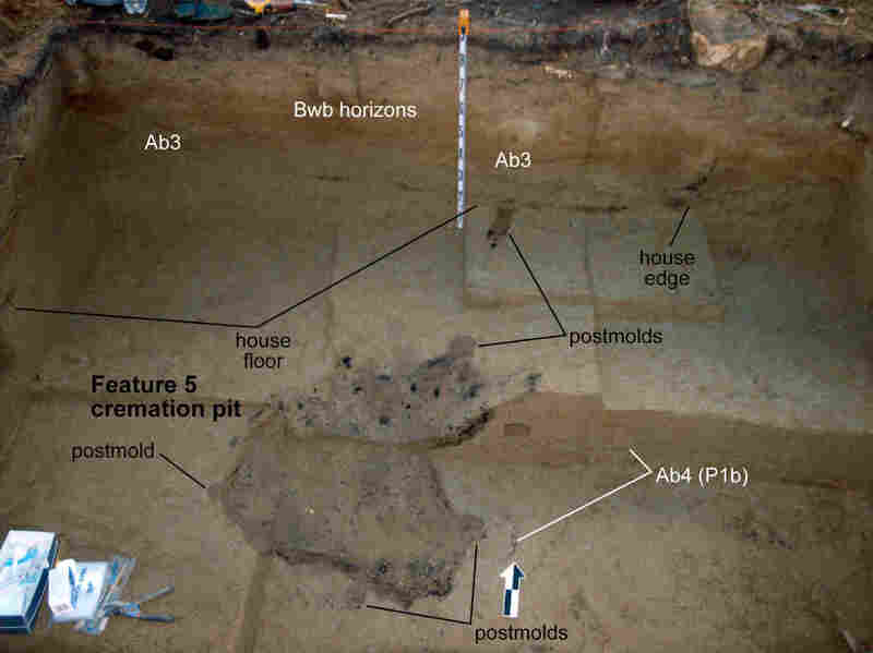 A photograph of the excavated burial site, with annotations by the researchers. In the center is the cooking hearth, where a 3-year-old child was cremated before the home was abandoned.