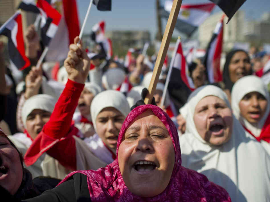 Egyptians shout slogans Cairo's Tahrir Square on February 18, 2011 during celebrations marking one week after Egypt's long-time president Hosni Mubarak was forced out of office by an unprecedented wave of protests