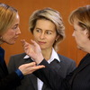 German Family Minister Kristina Schroeder (from left), Labor Minister Ursula von der Leyen and Chancellor Angela Merkel speak before a Cabinet meeting. Germany's 14-member Cabinet has five women, but women make up only 8.2 percent of the country's corporate board members.