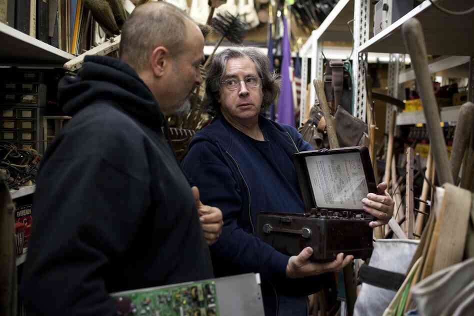 Jim Elyea (right), owner of the History for Hire prop house, helps  Ian Scheibel, the prop master for TV's Bones, pick out items for an upcoming episode. Elyea's 32,000-square-foot warehouse in North Hollywood, Calif., is stocked with hundreds of thousands of props spanning several eras.