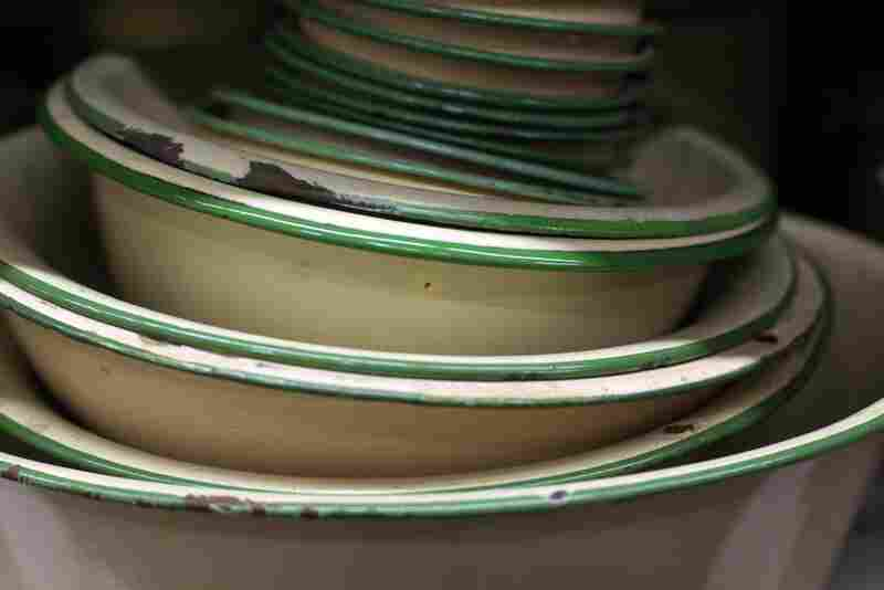 """Beige and green stacked bowls — made in the 1920s — are among the most popular items at History for Hire, because they quickly convey the feel of the 1920s and '30s. """"Put a stack of them in the sink or on the table, and most people know they are looking into an earlier time period,"""" Elyea says."""