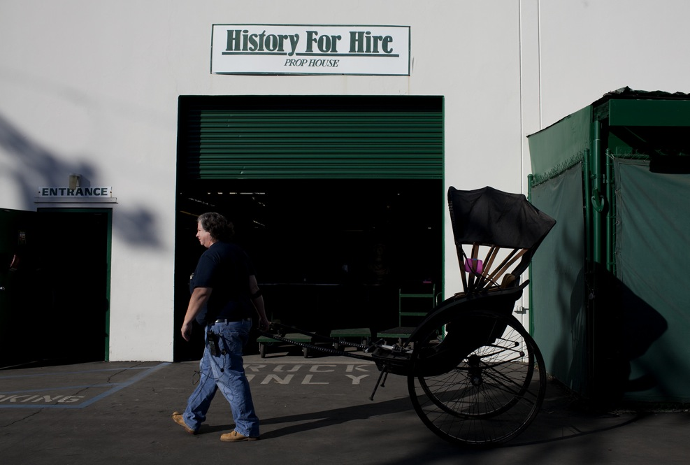 "Outside the warehouse, Elyea wheels a rickshaw used in several movies, including some filmed in Asia. ""We've shipped rickshaws to Japan, ski goggles to Norway and Pepsi bottles to Pepsi,"" Elyea says. History for Hire props have been to all seven continents."