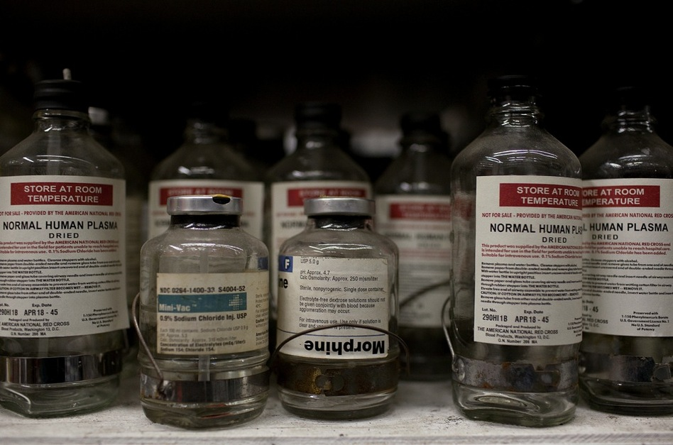 Glass medicine bottles are among the props available for rent at History for Hire. The bottles are original, but the lids, labels and stoppers are reproductions. They've been used in movies such as Flags of our Fathers and an upcoming HBO special on Ernest Hemingway. (Katie Falkenberg for NPR)