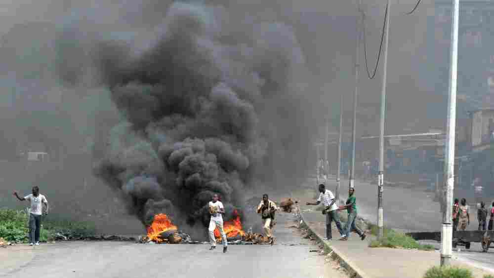 Supporters of Alassane Ouattara burn tires in Abidjan. Residents in at least one Abidjan neighborhood that supported Ouattara reported heavy weapons fire.