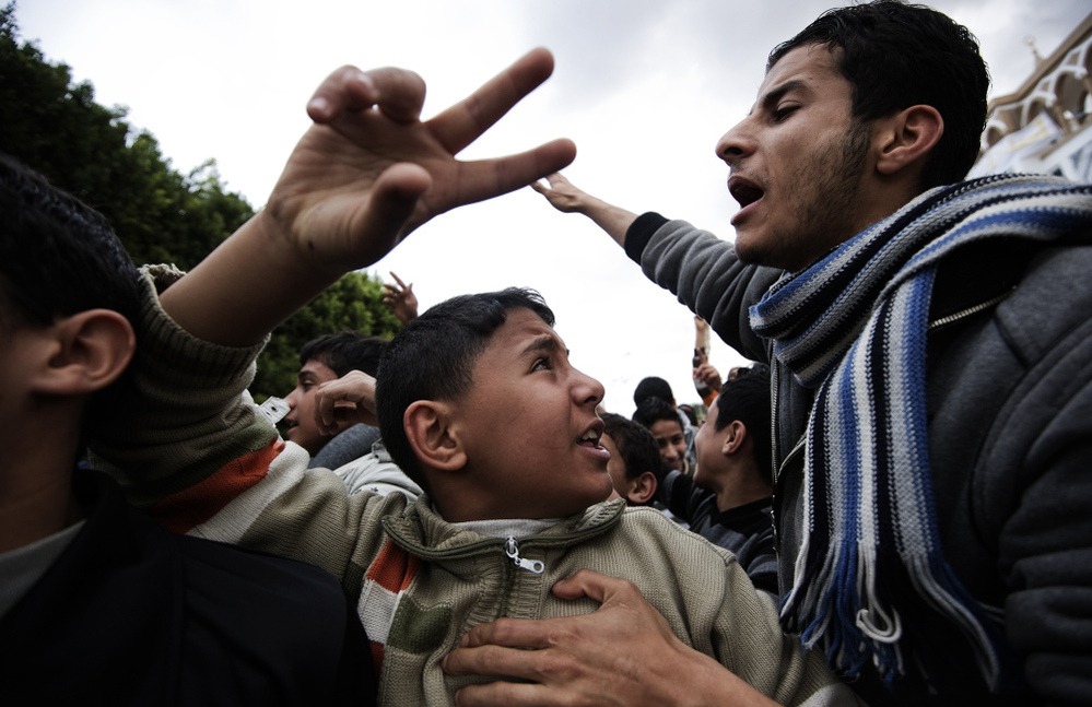 Libyans shout anti-Gadhafi slogans during a demonstration in the eastern town of Derna, between Tobruk and Benghazi.