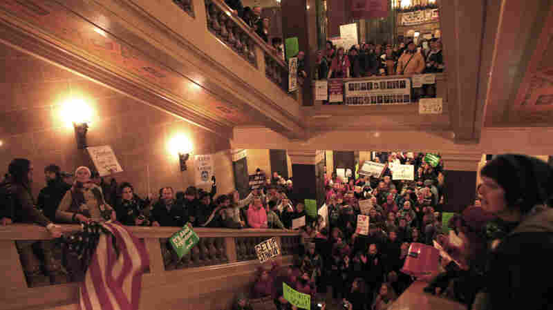 Protesters demonstrate outside the office of Wisconsin Gov. Scott Walker during his fireside chat Tuesday at the Capitol.