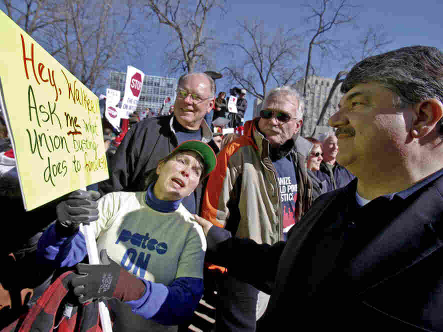 Richard Trumka, right, AFL-CIO president, talks with retired postal worker Judy Bukowski outside Wisconsin's State Capitol in Madison.