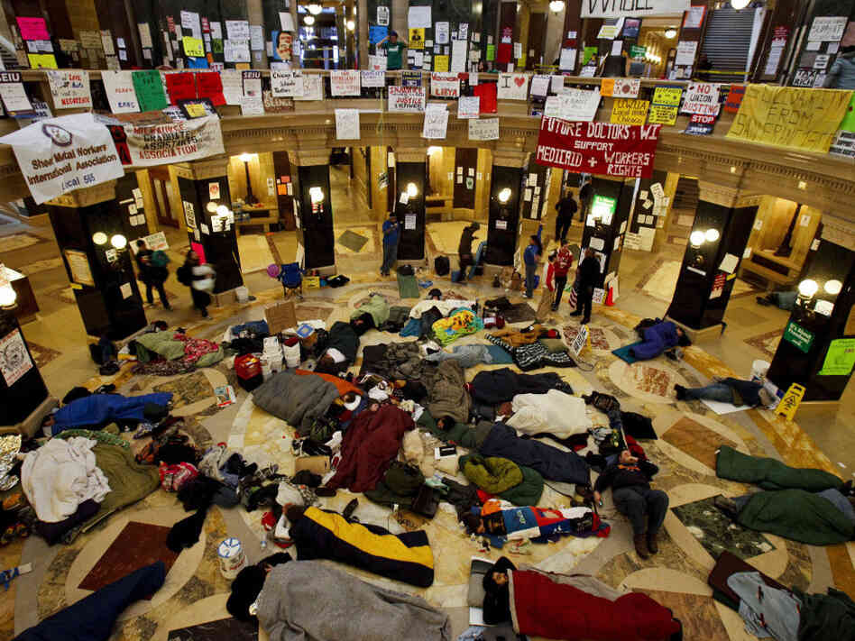 Wisconsin protesters sleep in the state capitol's rotunda, early Thursday.