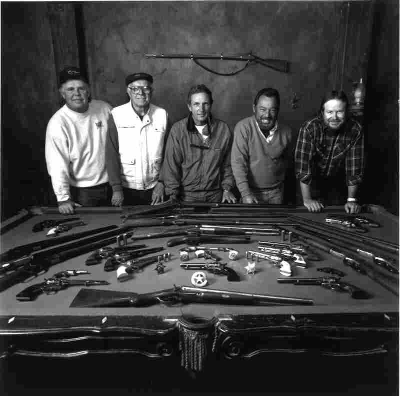 Prop master Bill Petrotta (center) armed Kevin Costner for the 1994 film Wyatt Earp,  with help from assistant prop master Mike Gannon (left), armorer Bronco  Wohlsharp, brother Vic Petrotta  and assistant prop master Billy Rae.
