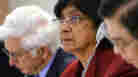 "Navi Pillay, the United Nations' high commissioner for human rights, looks on during a Human Rights Council special session on the crisis in Libya on Friday in Geneva. Pillay said the world must ""step in vigorously"" to protect Libyan protesters."