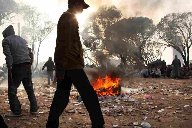 Trash fires burn at a border area in Tunisia on Thursday, where migrant workers from Libya are living in squalid conditions. Tunisia's situation is quickly turning into a humanitarian emergency as the country is overwhelmed with refugees.