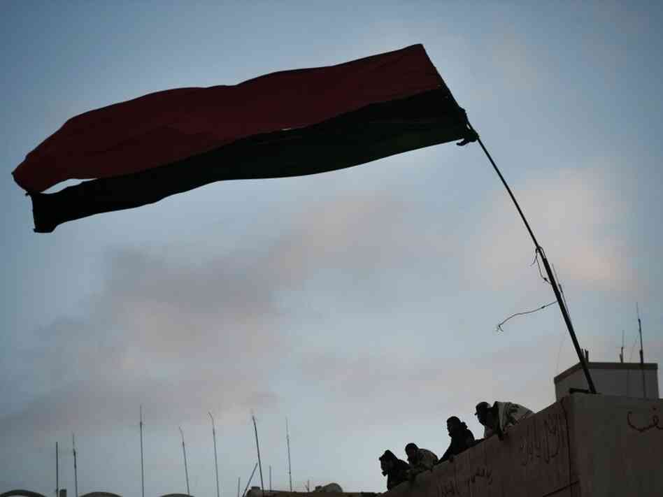 The old (pre-Gadhafi era) Libyan national flag flew outside the courthouse in the eastern city of Benghazi on Thursday (Feb. 24, 2011).
