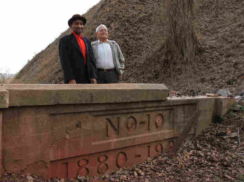 Former miners Willie Cammack (left) and Amos Horton, standing at the entrance to the No. 10 mine where they used to work.