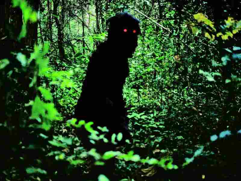 Aided by shadowy, red-eyed creatures like this one, Boonmee treks through the jungle with his family to find the hilltop cave where his first life began.