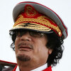 Libyan  leader Moammar Gadhafi speaks in Tripoli on June 12, 2010, during a ceremony marking the 40th anniversary of  the evacuation of the American military bases in the country.