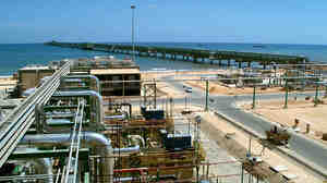 A production plant on the short of Mellitah, Libya, opened in 2004. Owned by Eni, the Italian oil and gas company, the facility is part of a pipeline that connects Libya to Sicily. Political unrest in the African nation is having effects in the worldwide oil market.