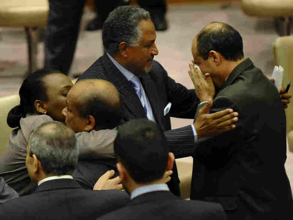Libya's U.N. Ambassador Abdurrahman Mohamed Shalgham is embraced by a colleague (lower left) while his deputy, Ibrahim Dabbashi, weeps following Shalgham's speech denouncing Moammar Gadhafi Friday.