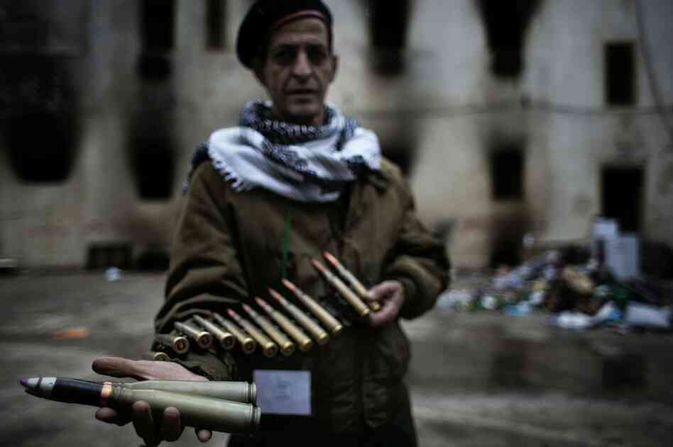A Libyan insurgent soldier displays heavy-caliber ammunition, allegedly intended to be used against civilians in Benghazi on Sunday.
