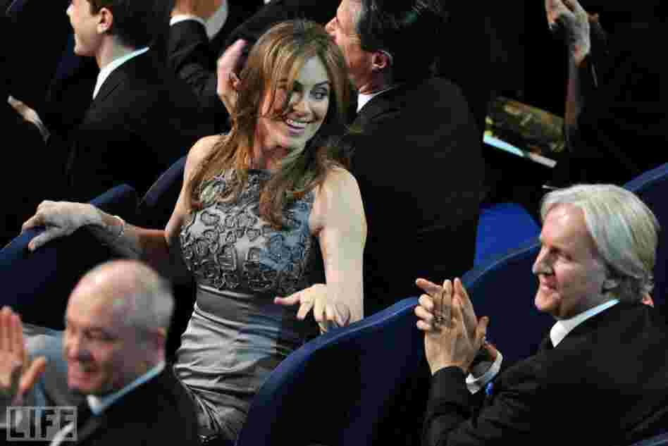 During the 2010 Oscars, The Hurt Locker director Kathryn Bigelow  glances back at her ex-husband, Avatar director James Cameron. Their movies had been competing all Oscar season. On the big night,  Bigelow's movie came out on top, scoring six wins to Avatar's three. Bigelow became the first-ever female director to win an Oscar.