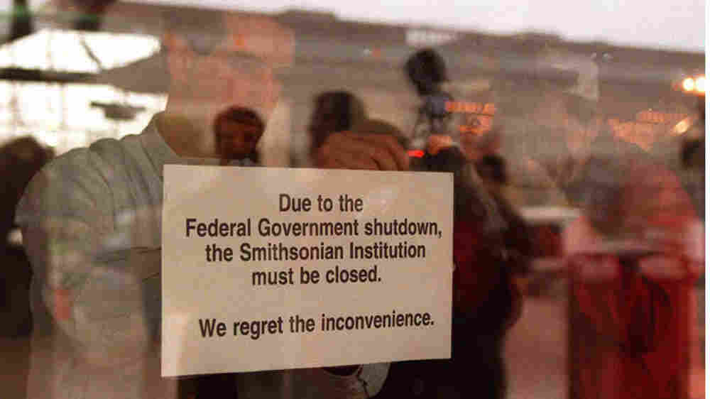 In November 1996, an employee at the National Air and Space Museum in Washington, D.C., hangs a sign explaining the reason for the museum closure. If Congress and the president can't reach an agreement on federal spending by March 4, the U.S. could see a repeat of that government shutdown.