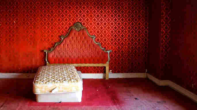 A deliciously creepy, dilapidated red room: the penthouse suite at L.A.'s  Alexandria Hotel.