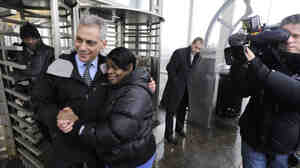 "Chicago mayoral candidate Rahm Emanuel poses with constituents at an ""L"" station in Chicago Tuesday."