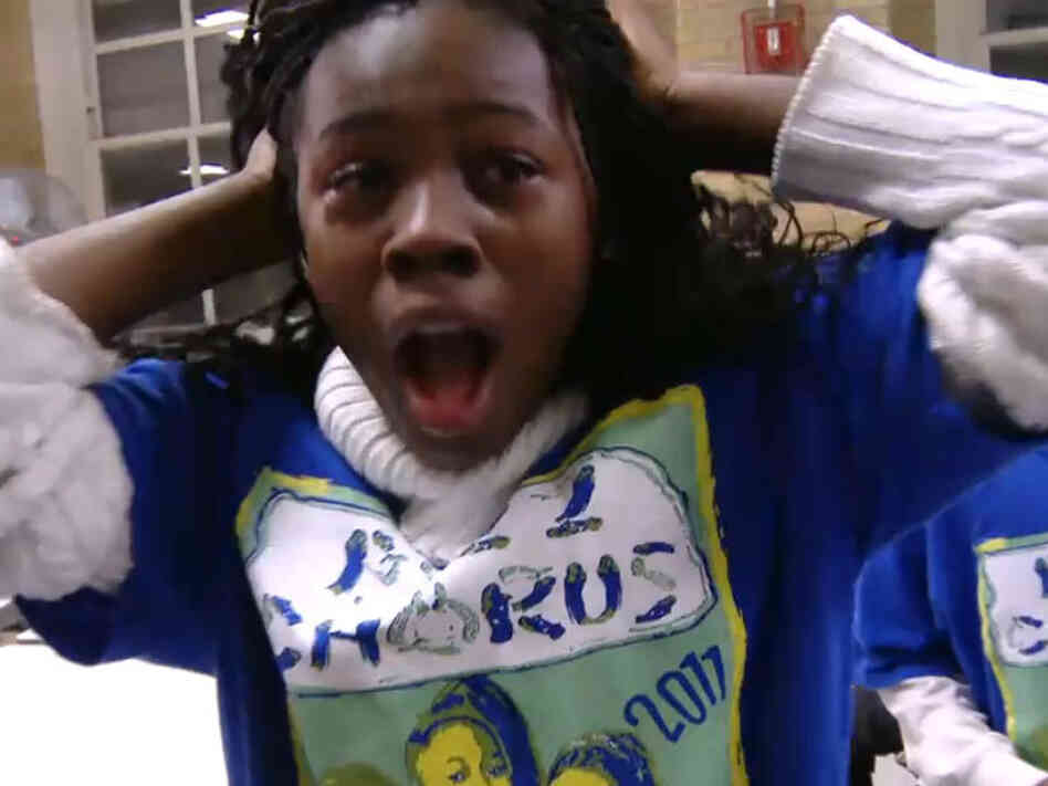 A PS22 Chorus member reacts to news that their glee club will perform at the Academy Awards.