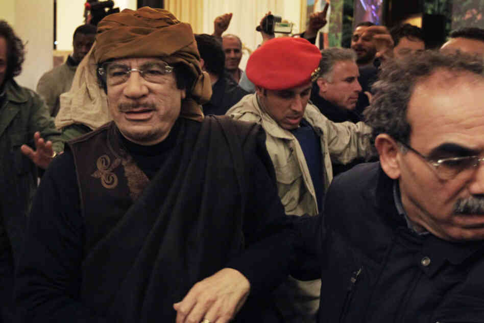 Libyan leader Moammar Gadhafi arrives at a hotel to give television interviews in Tripoli on Tuesday.