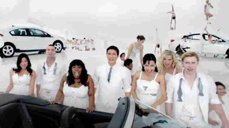 The cast of the TV show Glee sells Chevys in this Super Bowl ad.