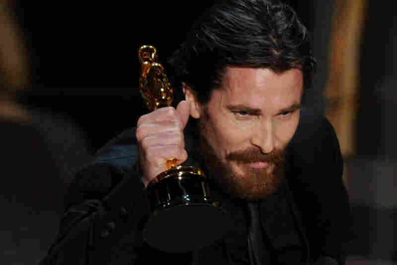 Christian Bale receives the Best Supporting Actor award, his first Oscar, for his role in The Fighter.