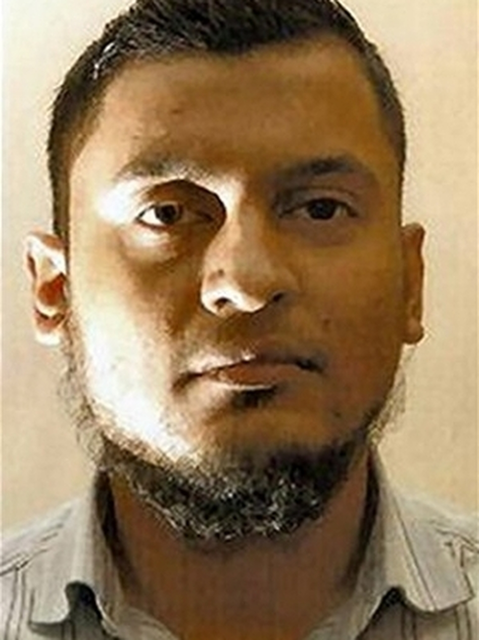 A jury has convicted former British Airways computer specialist Rajib Karim, seen in a photo provided by the police, of plotting with U.S.-born extremist cleric Anwar al-Awlaki to blow up an airplane.