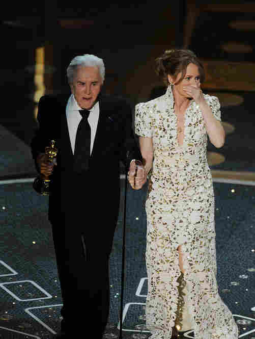 Melissa Leo took the Best Supporting Actress Oscar for her performance in The Fighter, presented by Hollywood legend Kirk Douglas.