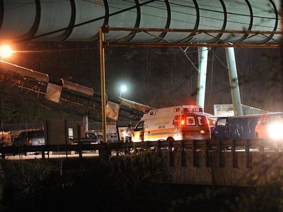 An ambulance arrives on the scene on April 10, 2010, after an explosion at Upper Big Branch mine in West Virginia. Twenty-nine workers died in the blast. (AP)