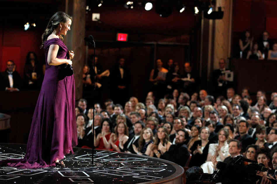Natalie Portman accepts the Oscar for Best Actress for her performance in Black Swan.