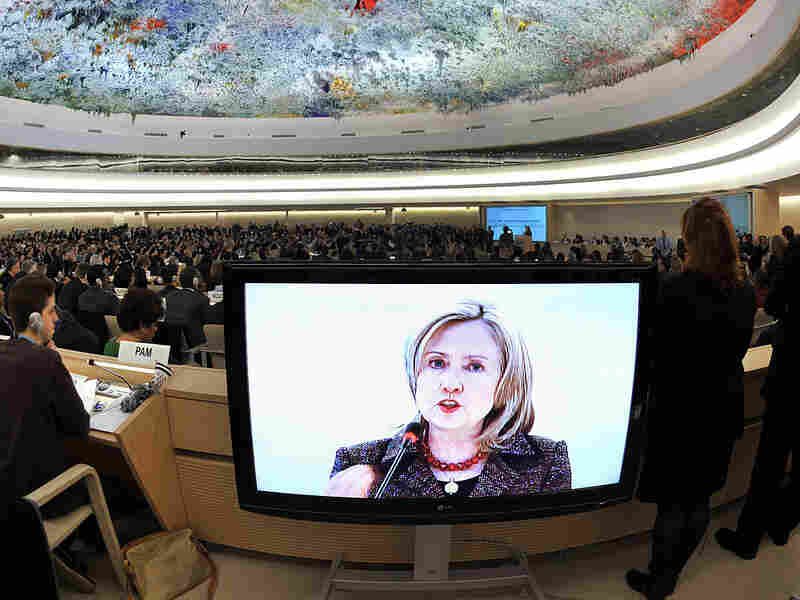U.S. Secretary of State Hillary Clinton is seen on a TV screen while delivering a speech Monday before the United Nations Human Rights Council in Geneva.