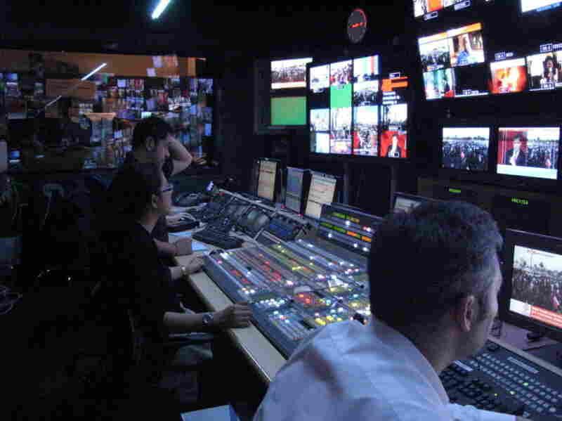 Al-Jazeera staff members prepare for a broadcast in Doha, Qatar.