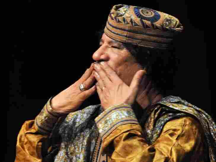 Libyan leader Moammar Gadhafi blowing kisses to the audience after delivering a speech in Rome in 2009. Gadhafi still clings to power this week as protests continue to upset Libya.