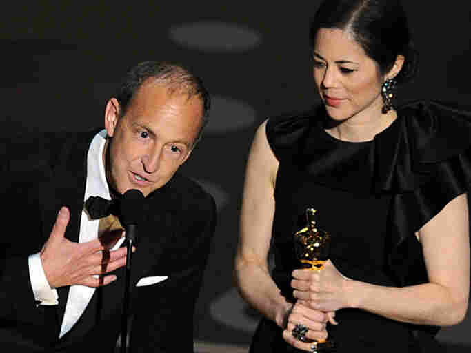 """The winners of the Best Documentary Feature """"Inside Job,"""" Charles Ferguson and Audrey Marrs address the audience the 83rd Annual Academy Awards."""